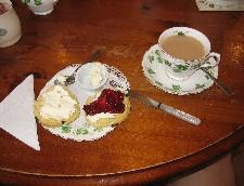 tea with scones, jam, and clottedcream