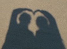 Wessel & Diane make a shadow heart at the beach; CLICK ON PHOTO