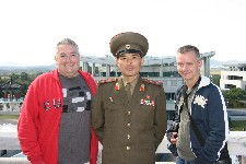 Jim Augusto and Jon Cramer with North Korean tour guide at DMZ