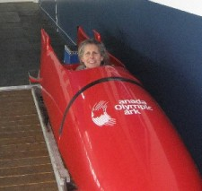 Diane sits in bobsleigh