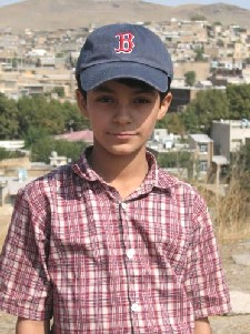 Young boy near the Iraq border with Red Sox hat from Dobrow