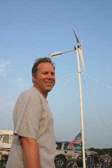 Michael Powers next to his self-built wind turbine