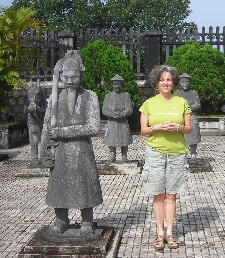 Barbara Levitov at Tomb of Khai Dinh among statues of bodyguard soldiers