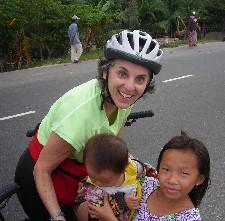 Barbara Levitov biking along fishing villages meeting children