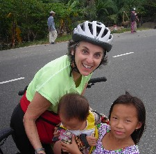 Barbara Levitov biking along fishing villages meeting children