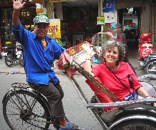 Barbara Levitov leisurely rides cyclo in Hanoi to end her biking trip