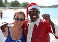 Carla Ramos, with Santa (who just waterskiied into shore), Rendezvous Resort, St. Lucia