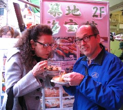 Ellen Rovner and Michael Zimman sampling scallops at the Tokyo fish market
