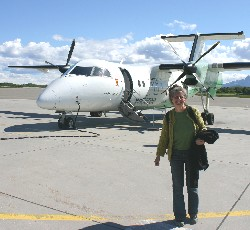 Diane, a.k.a. Lady Di, in front of a 40-seater Widerøe airplane