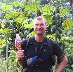 Hudson Doyle holding a banana flower, hiking in the jungle in Chiang Rai, northern Thailand