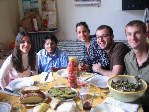 Hudson Doyle (far right) eating lunch with couchsurfing hosts in Torino, Italy