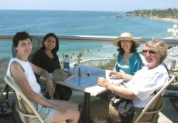 From left, Kathy McIntyre, Linda Hayes, her sister Janet Lurie, and Chris Ward savor Main Beach in Laguna Beach, Calif. (Click to enlarge)
