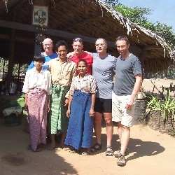 Back Row (l to r) Gary Kelly, Curt Allen, Michael Romanow, Trond Skramstad with a family at a small shop along the road from Mt. Popa to Bagan, Burma