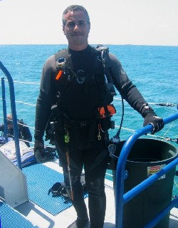 Russ Haims on a boat deck before diving in Bimini