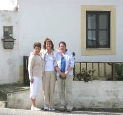 Carm Provost (left), Diane Charest, Pam Trett standing in front of their father's childhood home in Caldas da Rainha, Portugal