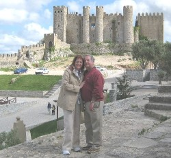 Diane and her husband John in front of Obidos castle