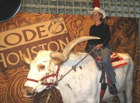 Diane riding the longhorn steer