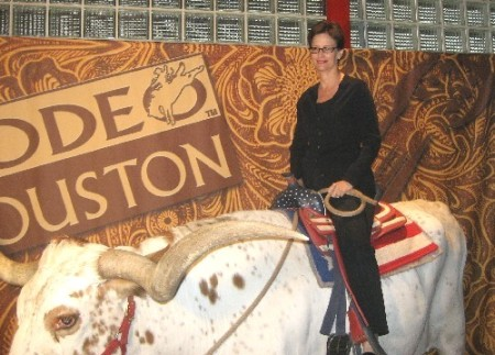 Jane Wooldridge riding the longhorn steer