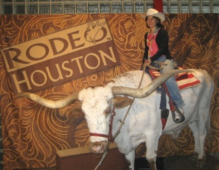 Ellen Perlman riding the longhorn steer