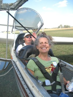 Diane in glider plane with pilot, Philippe Heer in back seat