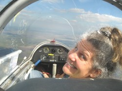 Diane in front of two-seater plane