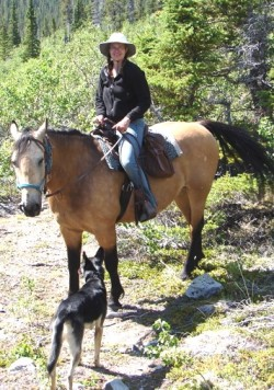 Cynthia Soroos rides a horse in the Yukon territory