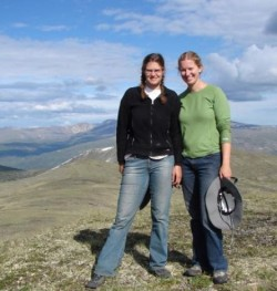 Cynthia (left) and sister Sarah Soroos on top of a mountain in the Yukon Territory