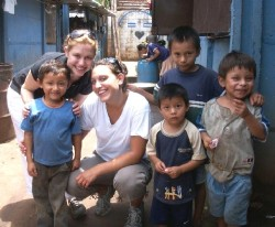 Allisa Whitman (left) and her sister Rachel Whitman surrounded by boys living in El Salvador.