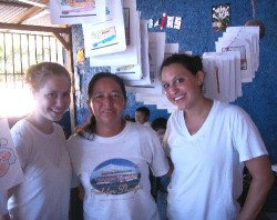 Allisa (left) and Rachel with Daisy Hernandez (center), community worker for the village in El Salvador that they visited.