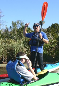 Matt Clemons (standing) during kayak trip convinced Diane to not swim with manatees