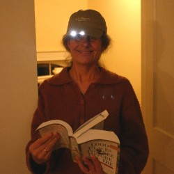 Reading books in the dark. One of teh many uses of the baseball cap with LED lights
