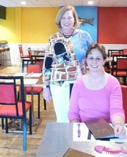 Jane Killeen (left) and Robin Killeen at the colorful Tin Fish restaurant in Lunenburg, Nova Scotia
