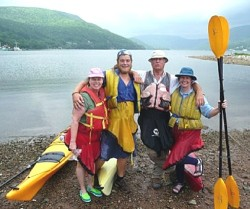 Jane (left) and Robin kayaking with guides Gordon and Mike Crimp (center) of Cape Breton Seacoast Adventures in Ingonish, Nova Scotia.