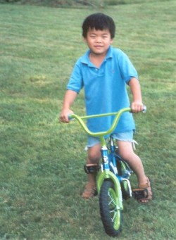 A grassy lawn is a great place for 5-year old Jack Tuttle to get bike-riding lessons
