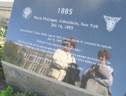 Diane Reilly (left) and Rachel Farley look at memorial marker