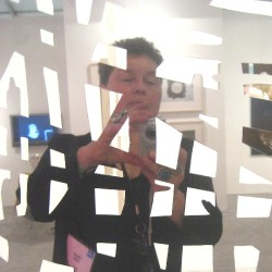 Joanne Mattera at Art Basel Miami Beach, reflected in screen by Mark Fox
