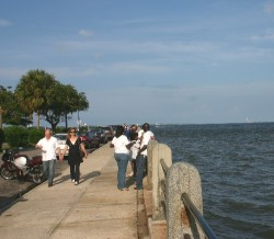 People enjoy a late-day stroll in Battery Park