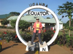 Debra standing on the equator in Uganda