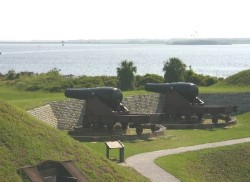 Fort Moultrie's canons are pointed to the entrance of Charleston Harbor