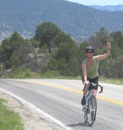 Friend Kelley reaches the top during a ride outside Salida