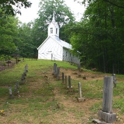The 1889 Baptist Church sit on top of a ridge