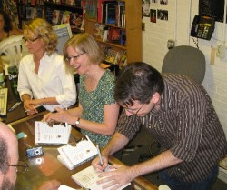 Margaret Sartor (left), Patty Van Norman, and Michael sign books