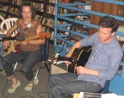 Laura and Mac play a song during the presentation of their book