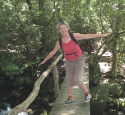 Tree pose on footbridge for beginners