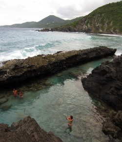 Visitors wade in one of the tidal pools at Annaly Bay, St. Croix