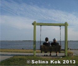 Waterfront Park, overlooking the Cape Fear River, is a popular spot for relaxing