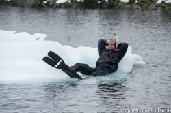 Taking a break while polar snorkeling (photo Roger Munns - Waterproof Expeditions)