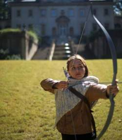 Learn archery while touring Hunger Games sites in Atlanta, such as The Swan House, staged at Presidents Snow's Mansion.  Photo credit: Hunger GamesTM Unofficial Fan Tours