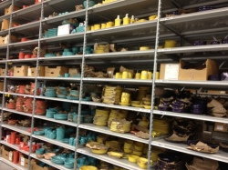The shelves holding Fiestaware are among the most colorful in Replacements' massive warehouse.