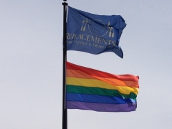 The rainbow flag flies under the Replacements logo. Owner and founder Bob Page is known as a gay rights leader locally and statewide.